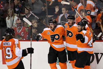 PHILADELPHIA - JUNE 09:  Danny Briere #48 of the Philadelphia Flyers celebrates with teammate Lukas Krajicek #2, Kimmo Timonen #44 and Scott Hartnell #19 after scoring a goal in the second period against the Chicago Blackhawks in Game Six of the 2010 NHL