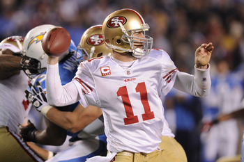 SAN DIEGO, CA - DECEMBER 16:  Quarterback Alex Smith #11 of the San Francisco 49ers drops back to pass against the San Diego Chargers at Qualcomm Stadium on December 16, 2010 in San Diego, California.  (Photo by Harry How/Getty Images)