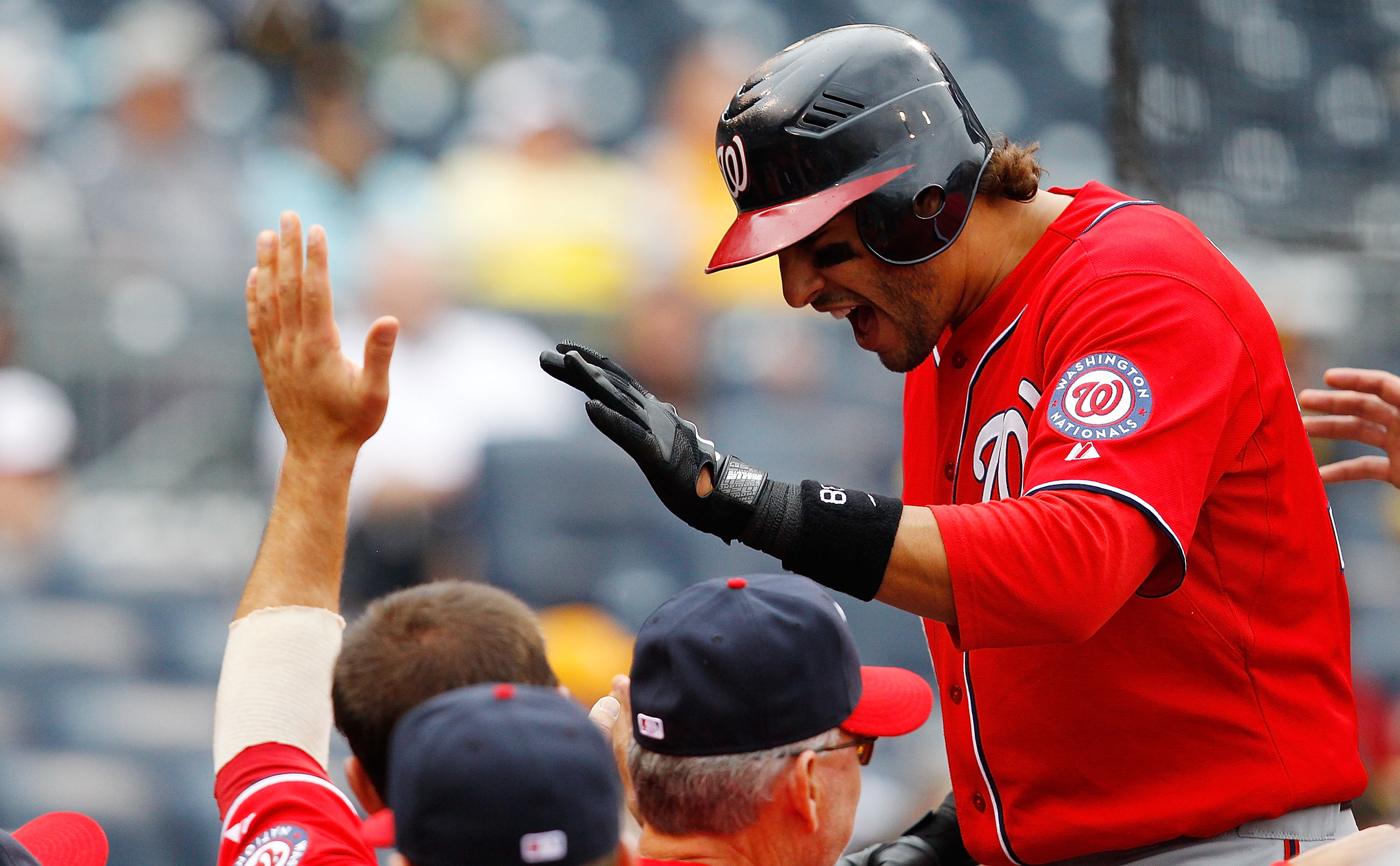 PITTSBURGH - APRIL 24:  Michael Morse #38 of the Washington Nationals celebrates with teammates after hitting a three run home run against the Pittsburgh Pirates during the game on April 24, 2011 at PNC Park in Pittsburgh, Pennsylvania.  (Photo by Jared W