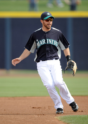 PEORIA, AZ - MARCH 01:  Dustin Ackley #13 of the Seattle Mariners plays second base against the Texas Rangers during spring training at Peoria Stadium on March 1, 2011 in Peoria, Arizona.  (Photo by Harry How/Getty Images)