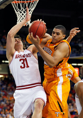 ATLANTA, GA - MARCH 10:  Michael Sanchez #31 of the Arkansas Razorbacks and Tobias Harris #12 of the Tennessee Volunteers fight for a rebound during the first round of the SEC Men's Basketball Tournament at the Georgia Dome on March 10, 2011 in Atlanta, G