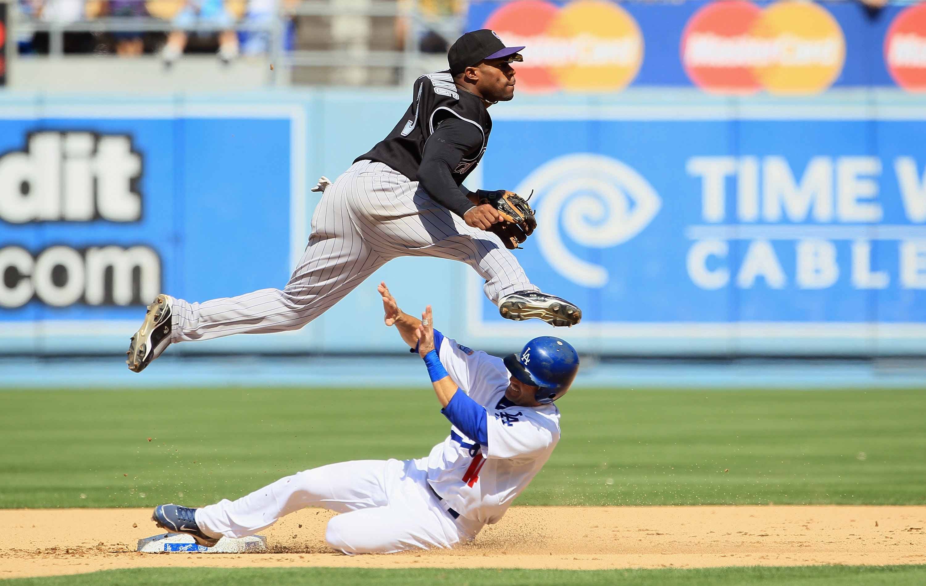 LOS ANGELES, CA - SEPTEMBER 18:  Second baseman Eric Young #3 of the Colorado Rockies jumps to avoid Jamey Carroll #14 of the Los Angeles Dodgers after forcing him out at second base in the fifth inning at Dodger Stadium on September 18, 2010 in Los Angel