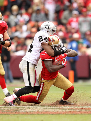 SAN FRANCISCO - OCTOBER 17:  Frank Gore #21 of the San Francisco 49ers is tackled by Michael Huff #24 of the Oakland Raiders at Candlestick Park on October 17, 2010 in San Francisco, California.  (Photo by Ezra Shaw/Getty Images)