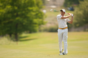 IRVING, TX - MAY 28: Sergio Garcia of Spain follows through on an approach shot during the third round of the HP Byron Nelson Championship at TPC Four Seasons at Las Colinas on May 28, 2011 in Irving, Texas. (Photo by Darren Carroll/Getty Images)