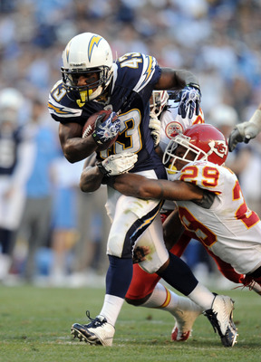 SAN DIEGO, CA - DECEMBER 12:  Darren Sproles #43 of the San Diego Chargers drags Eric Berry #29 of the Kansas City Chiefs on his run at Qualcomm Stadium on December 12, 2010 in San Diego, California.  (Photo by Harry How/Getty Images)