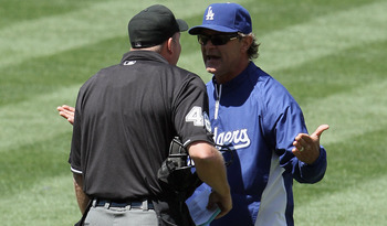 LOS ANGELES, CA - MAY 29:  Los Angeles Dodgers manager Don Mattingly (R) argues with home plate umpire Ron Kulpa in the top of the fifth inning against the Florida Marlins at Dodger Stadium on May 29, 2011 in Los Angeles, California. The Dodgers defeated