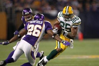 MINNEAPOLIS - NOVEMBER 09:  Running back Ryan Grant #25 of the Green Bay Packers carries the ball against cornerback Antoine Winfield #26 of the Minnesota Vikings on November 9, 2008 at the Metrodome in Mineapolis, Minnesota.  The Vikings won 28-27.  (Pho