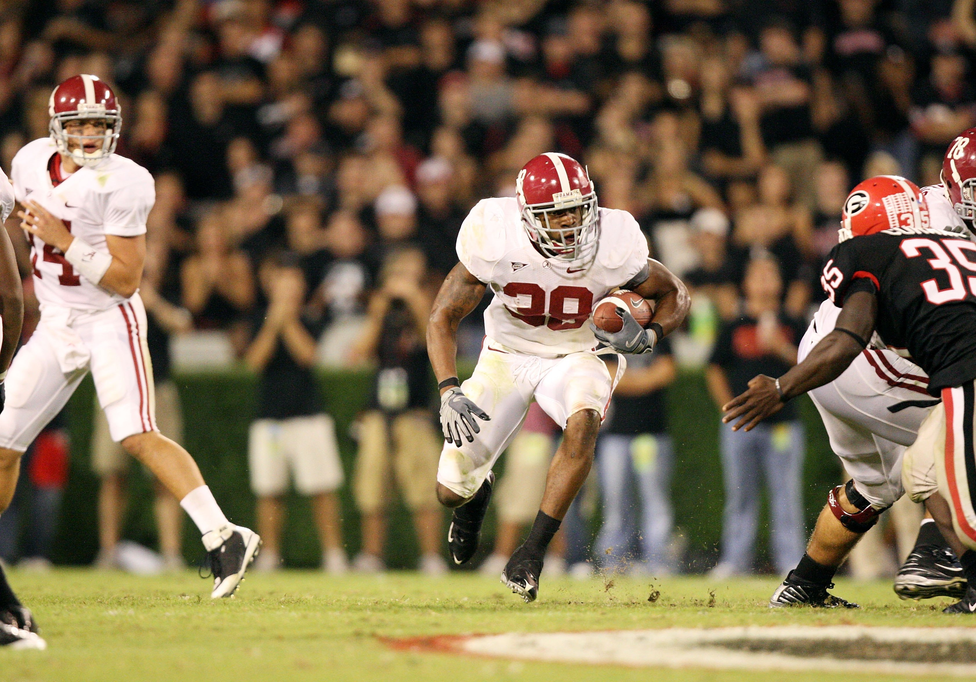 ATHENS, GA - SEPTEMBER 27:  Running back Donta Hightower #30 of the Alabama Crimson Tide takes the hand-off from quarterback John Parker Wilson and looks for room to run behind a block by Mike Johnson #78 while taking on the Georgia Bulldogs at Sanford St