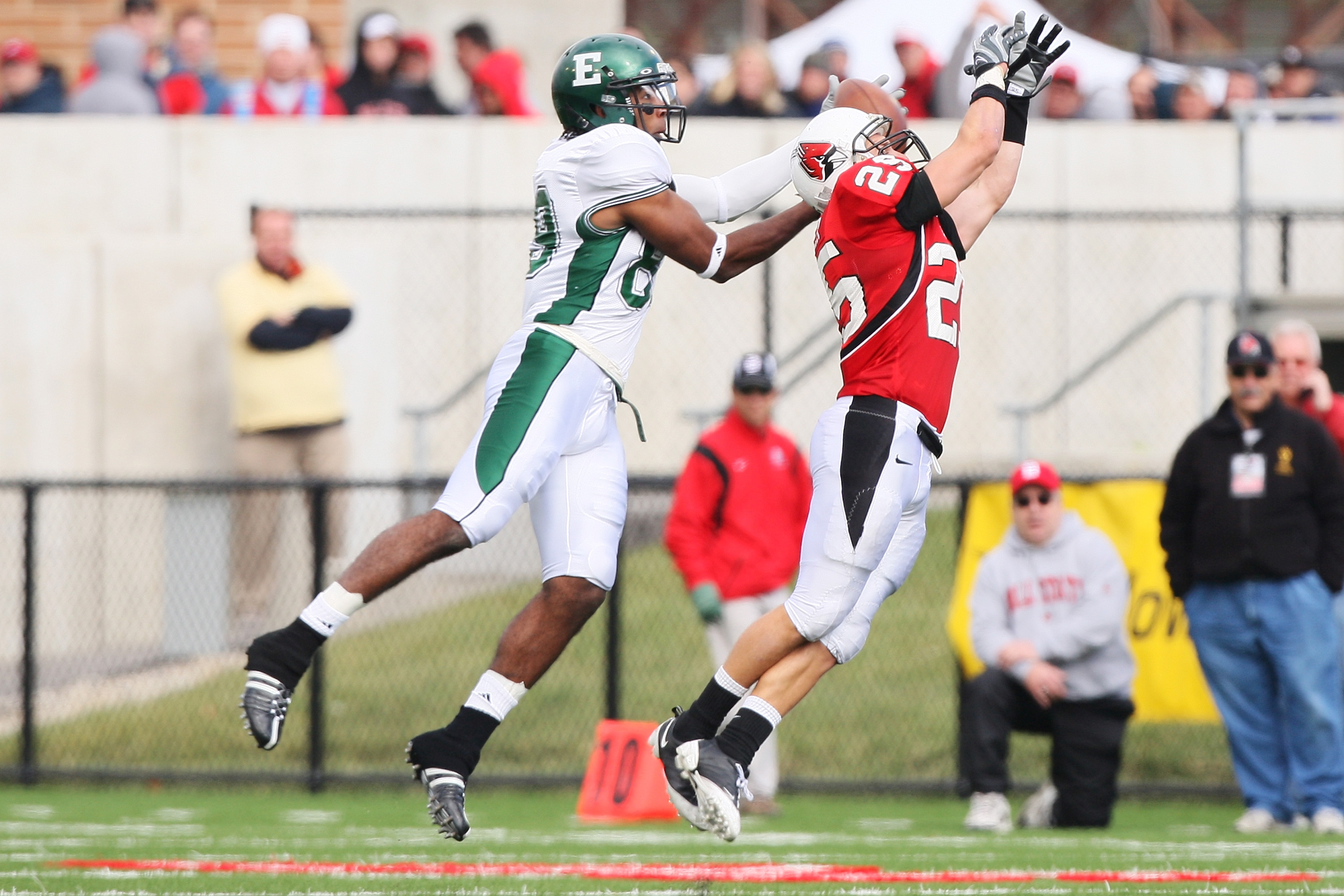 MUNCIE, IN - OCTOBER 25: Wide receiver Josh LeDuc #89 of the Eastern Michigan Eagles snares a pass reception from defensive back Sean Baker #25 of the Ball State Cardinals on October 25, 2008 at Scheumann Stadium in Muncie, Indiana.  (Photo by Jamie Sabau