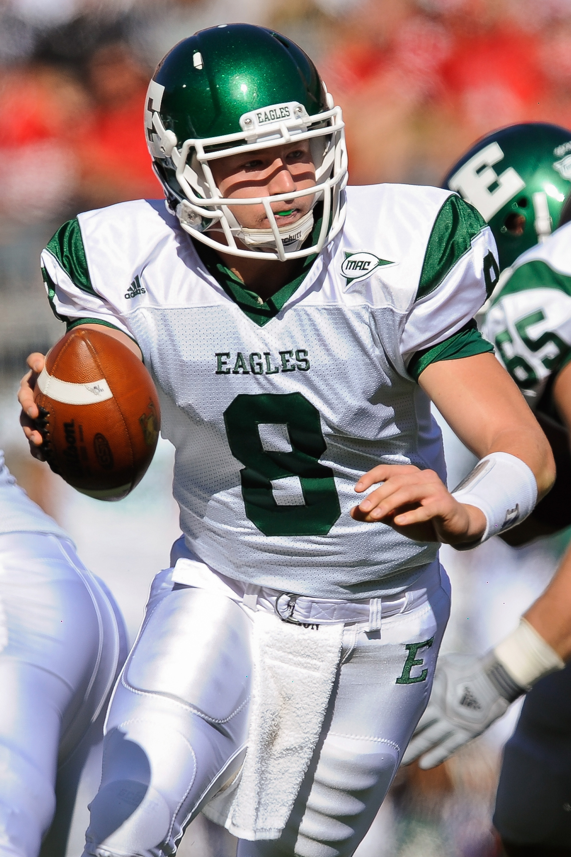 COLUMBUS, OH - SEPTEMBER 25:  Quarterback Alex Gillett #8 of the Eastern Michigan Eagles hands off the ball against the Ohio State Buckeyes at Ohio Stadium on September 25, 2010 in Columbus, Ohio.  Ohio State won 73-20. (Photo by Jamie Sabau/Getty Images)