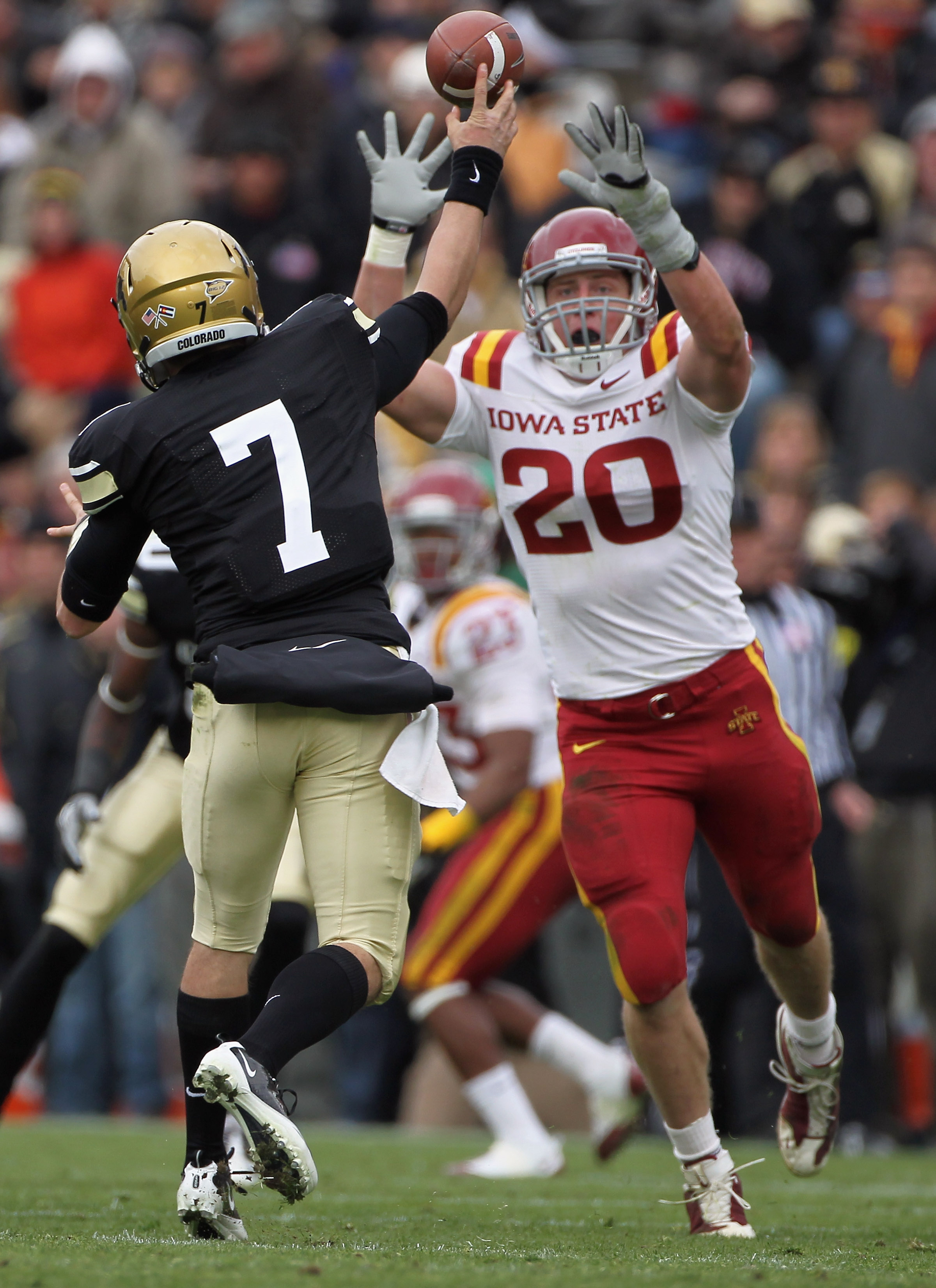 BOULDER, CO - NOVEMBER 13:  Quarterback Cody Hawkins #7 of the Colorado Buffaloes delivers a pass and has it knocked down by Jake Knott #20 of the Iowa State Cyclones at Folsom Field on November 13, 2010 in Boulder, Colorado. Colorado defeated Iowa State