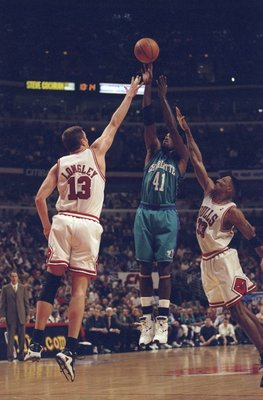 13 May, 1998:  Luc Longley #13 and Scottie Pippen #31 of the Chicago Bulls go up against Glen Rice #41 of the Charlotte Hornets for the ball during the NBA Eastern Conference Finals at the United Center in Chicago, Illinois.  The Bulls defeated the Hornet