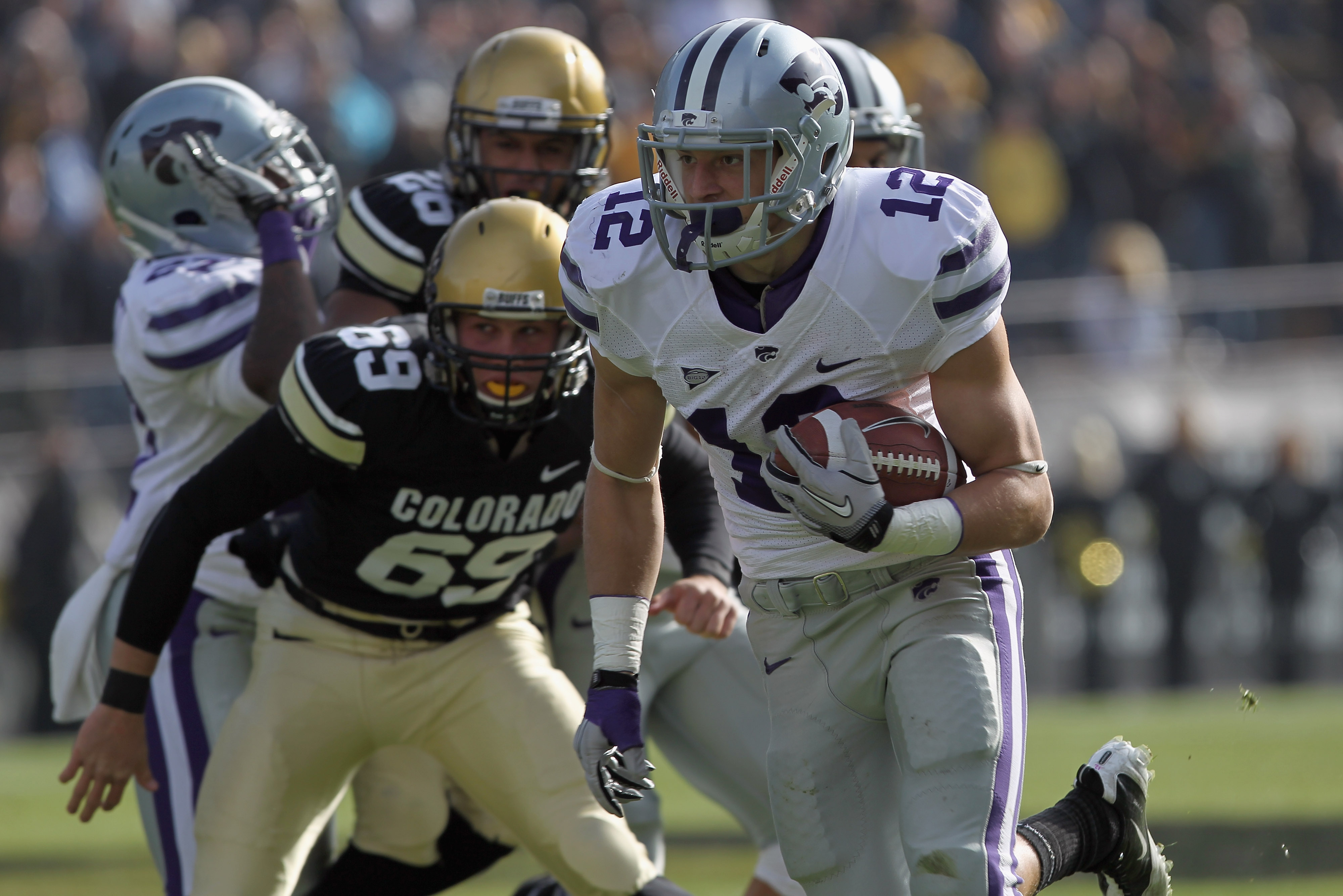 BOULDER, CO - NOVEMBER 20:  Ty Zimmerman #12 of the Kansas State Wildcats returns a punt to the one yard line against the Colorado Buffaloes in the first quarter at Folsom Field on November 20, 2010 in Boulder, Colorado. Colorado defeated Kansas State 44-