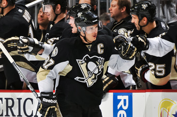 PITTSBURGH, PA - DECEMBER 20:  Sidney Crosby #87 of the Pittsburgh Penguins celebrates after scoring a goal against the Phoenix Coyotes on December 20, 2010 at CONSOL Energy Center in Pittsburgh, Pennsylvania.  (Photo by Jamie Sabau/Getty Images)