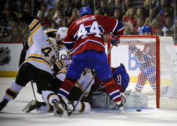 MONTREAL, CANADA - APRIL 26:  Zdeno Chara #33;Rich Peverley #49 and David Krejci #46 of the Boston Bruins battle for a loose puck in the crease against Roman Hamrlik #44 and Carey Price #31 of the Montreal Canadiens in Game Six of the Eastern Conference Q