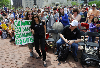 INDIANAPOLIS, IN - MAY 28:  Danica Patrick driver of the #7 Andretti Autosport Dallara Honda poses with fans during the parade for the 100th Anniversary of the Indianapolis 500 on May 28, 2011 in the streets of Indianapolis, Indiana.  (Photo by Robert Lab