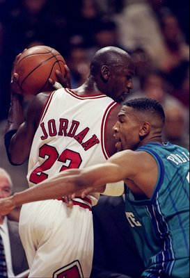 14 Nov 1997:  Guard Michael Jordan of the Chicago Bulls tries to fend off guard Bobby Phills of the Charlotte Hornets during a game at the United Center in Chicago, Illinois.  The Bulls won the game 105-92. Mandatory Credit: Jonathan Daniel  /Allsport