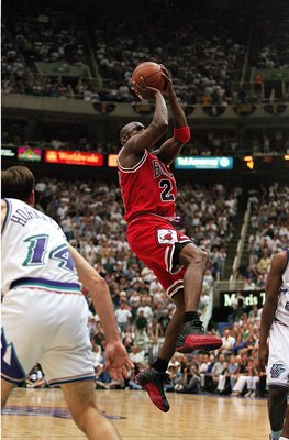 11 Jun 1997:  Michael Jordan #23 of the Chicago Bulls takes a shot at the basket during game five of the NBA Finals against the Utah Jazz at the Delta Center in Salt Lake City, Utah. The Bulls defeated the Jazz 90-88.   Mandatory Credit: Brian Bahr  /Alls