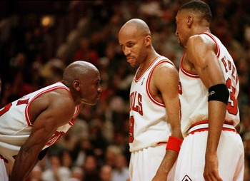 7 Jun 1996:  Michael Jordan of the  Chicago Bull, left, discusses strategy with teammates Ron Harper, center, and Scottie Pippen during a time-out on the court during the fourth quarter of game two in the NBA Finals at the United Center in Chicago, Illino
