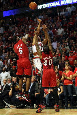 CHICAGO, IL - MAY 26:  Derrick Rose #1 of the Chicago Bulls misses the final shot attempt of the game at the buzzer against LeBron James #6 and Udonis Haslem #40 of the Miami Heat in Game Five of the Eastern Conference Finals during the 2011 NBA Playoffs