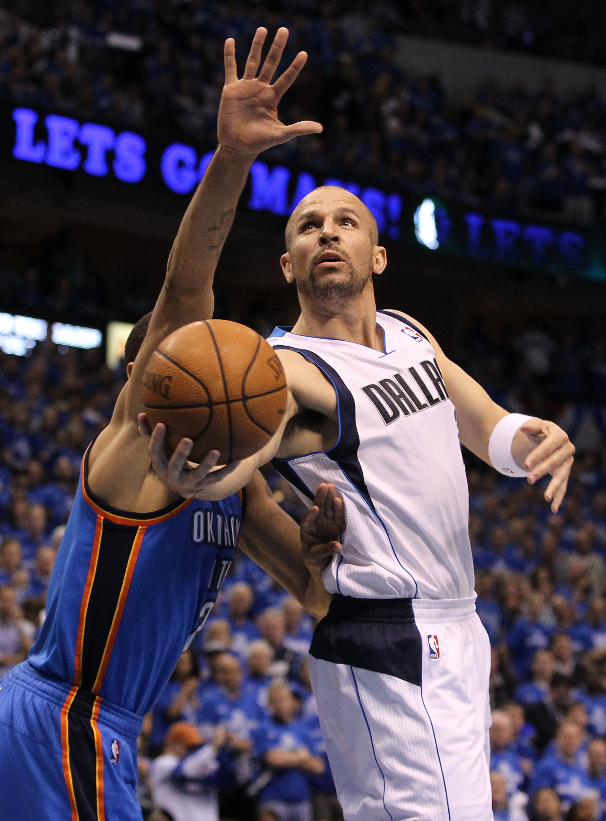 DALLAS, TX - MAY 25:  Jason Kidd #2 of the Dallas Mavericks goes up for a shot against Thabo Sefolosha #2 of the Oklahoma City Thunder in the first quarter in Game Five of the Western Conference Finals during the 2011 NBA Playoffs at American Airlines Cen