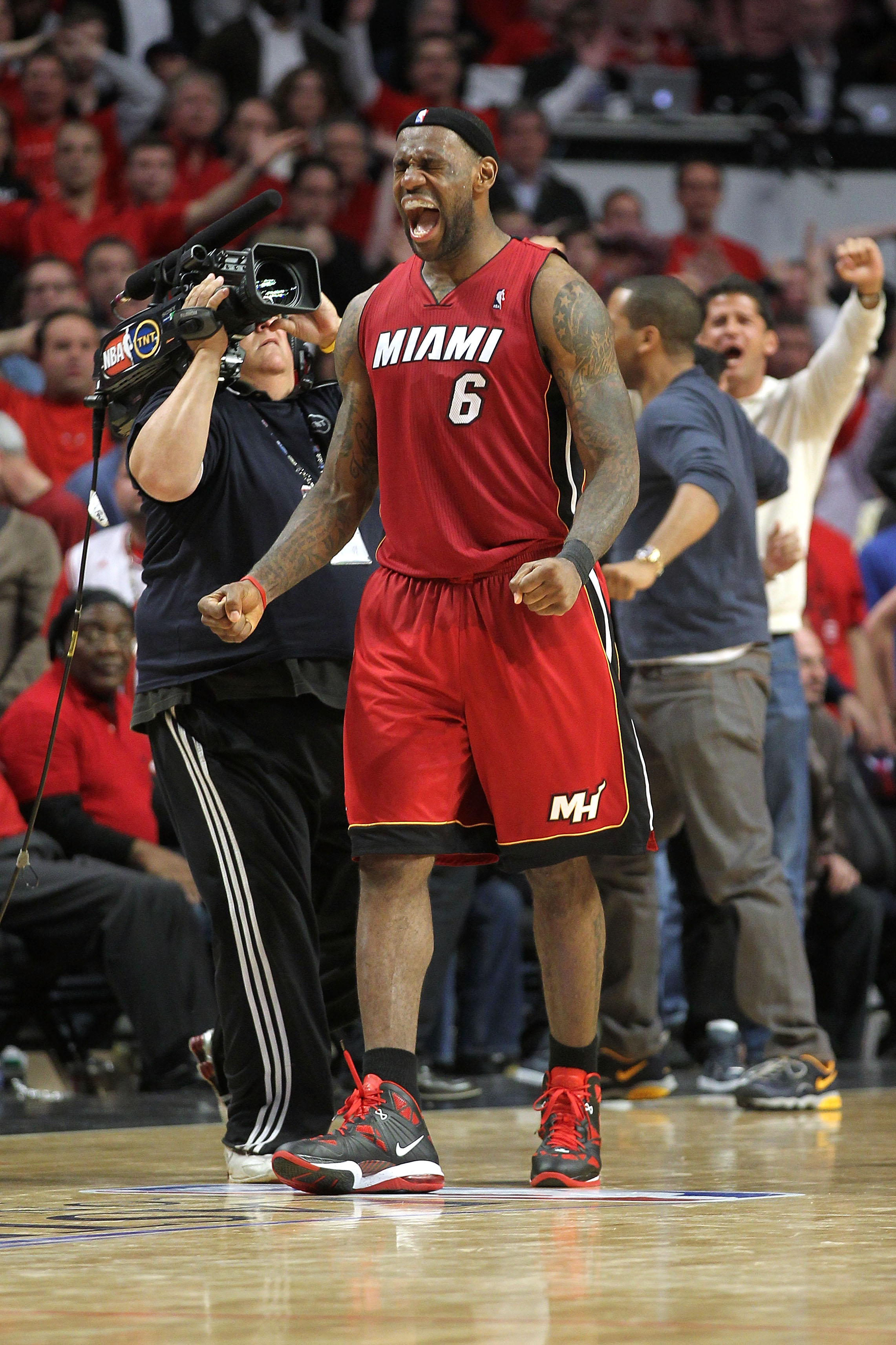 CHICAGO, IL - MAY 26: LeBron James #6 of the Miami Heat celebrates after the Heat won 83-80 against the Chicago Bulls in Game Five of the Eastern Conference Finals during the 2011 NBA Playoffs on May 26, 2011 at the United Center in Chicago, Illinois. NOT