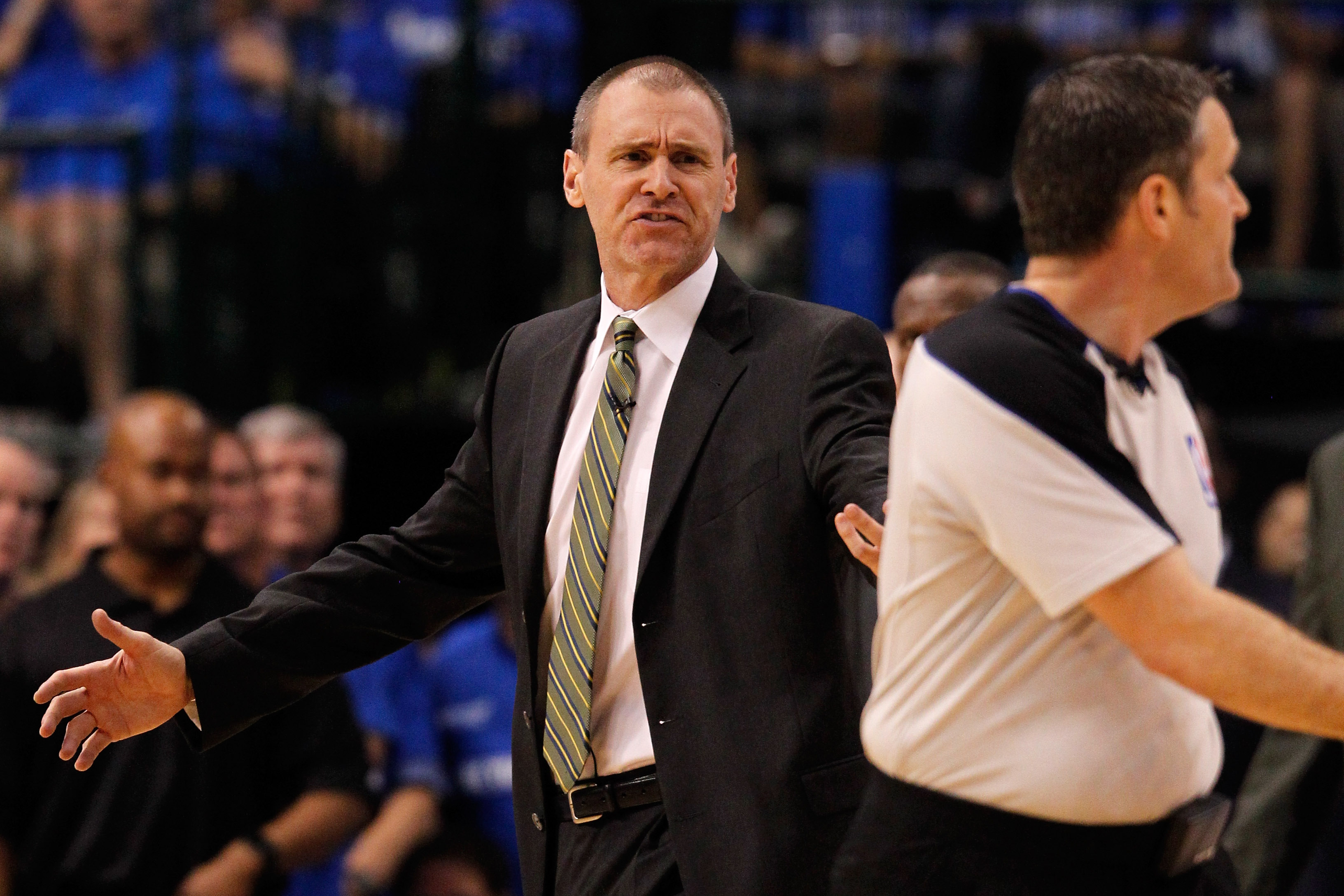 DALLAS, TX - MAY 25:  Head coach Rick Carlisle of the Dallas Mavericks looks over at referee Monty McCutchen #13 in the first half while taking on the Oklahoma City Thunder in Game Five of the Western Conference Finals during the 2011 NBA Playoffs at Amer