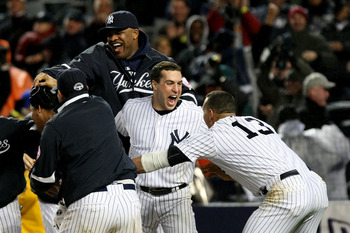 NEW YORK - OCTOBER 17:  CC Sabathia #52, Mark Teixiera #24 and Alex Rodriguez of the New York Yankees celebrate their 4-3 victory over the Los Angeles Angels of Anaheim in Game Two of the ALCS during the 2009 MLB Playoffs at Yankee Stadium on October 17,