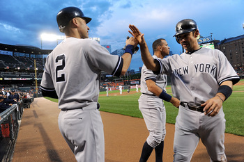 BALTIMORE, MD - MAY 19:  Jorge Posada #20 of the New York Yankees is congratulated by Derek Jeter #2 and Alex Rodriguez #13 after scoring in the first inning against the Baltimore Orioles at Oriole Park at Camden Yards on May 19, 2011 in Baltimore, Maryla