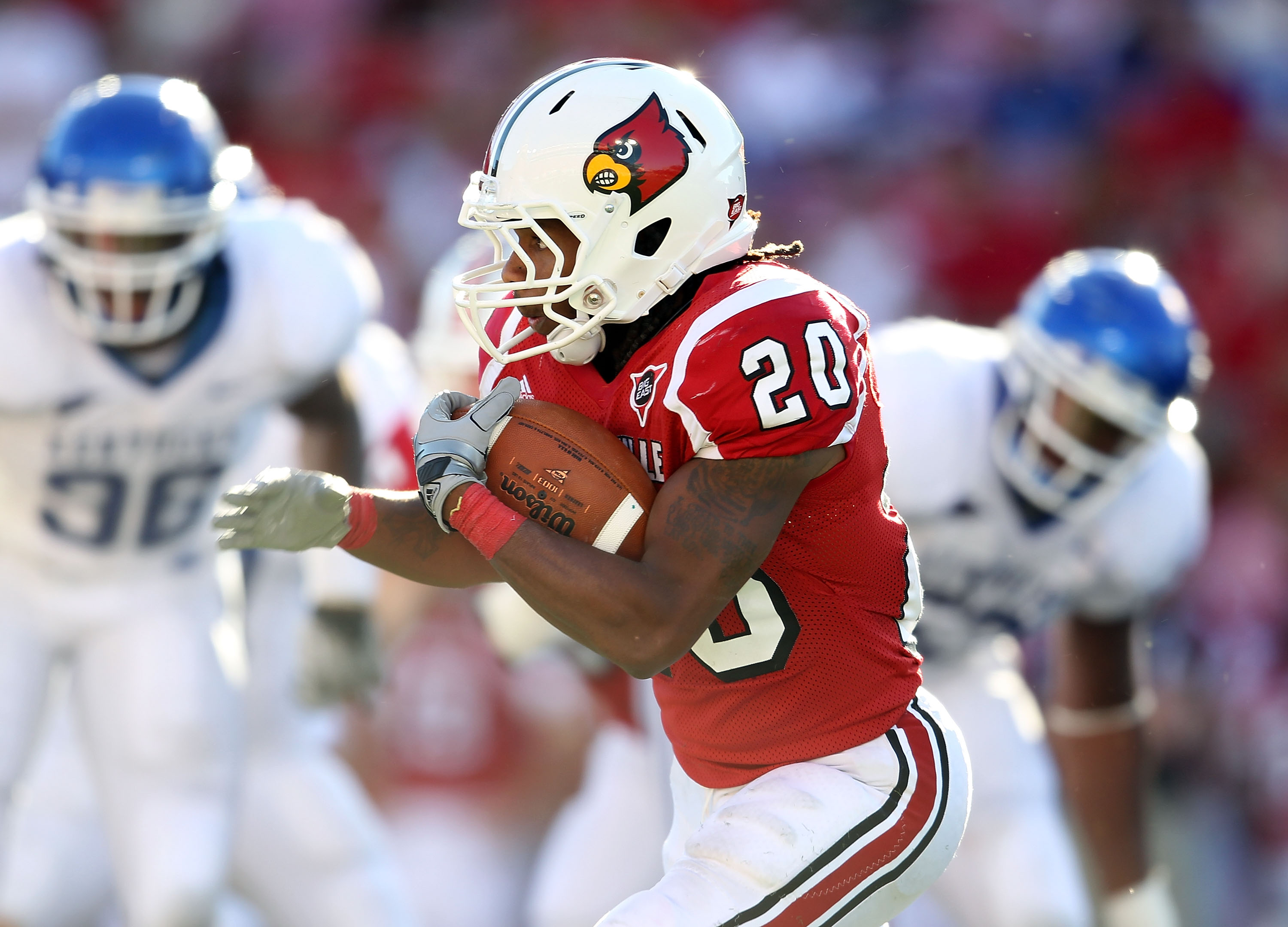 LOUISVILLE, KY - SEPTEMBER 04: Victor Anderson #20 of the Louisville Cardinals runs with the ball during the game against the Kentucky Wildcats at Papa John's Cardinal Stadium on September 4, 2010 in Louisville, Kentucky.  (Photo by Andy Lyons/Getty Image