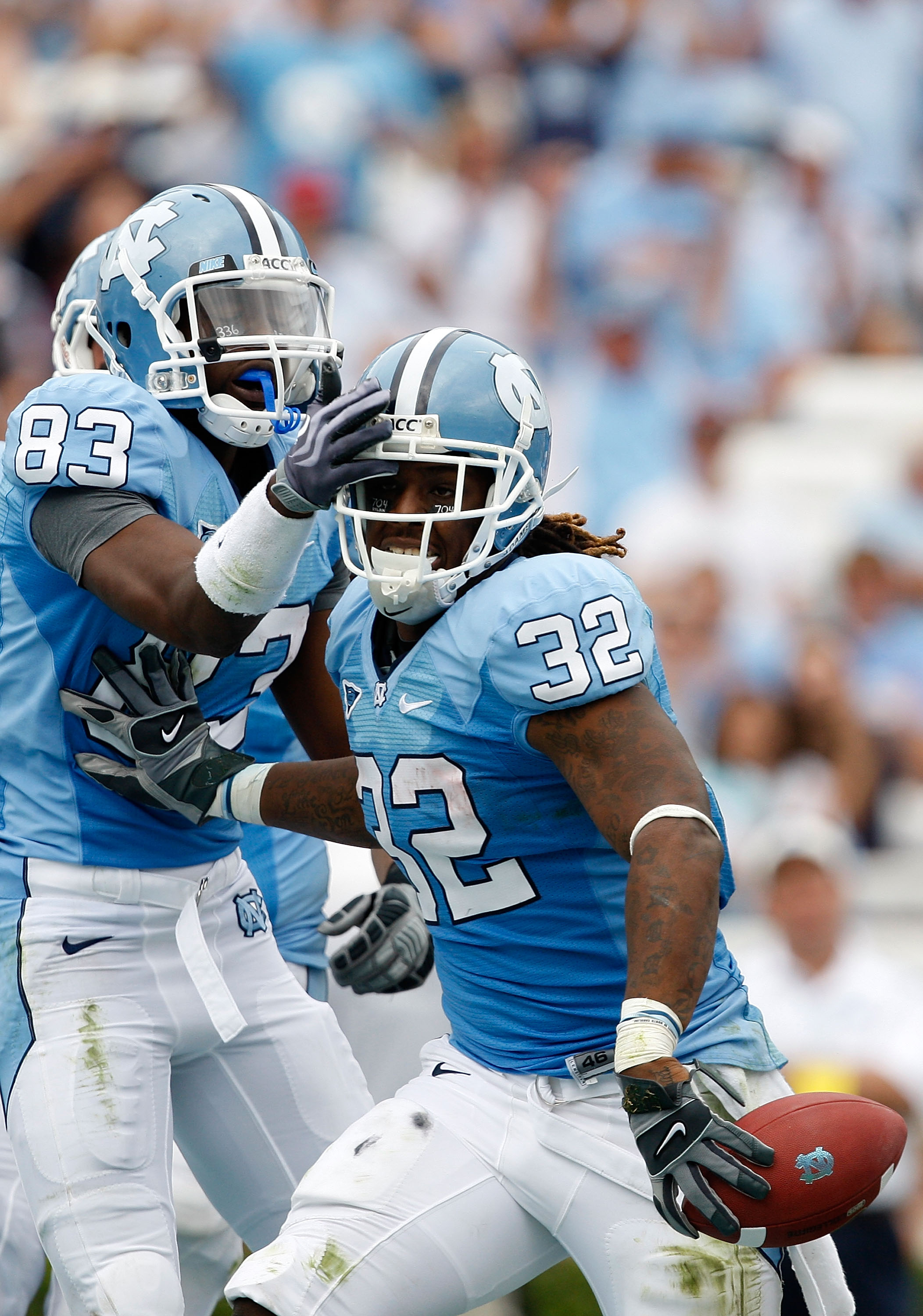 CHAPEL HILL, NC - OCTOBER 10:  Ryan Houston #32 of the North Carolina Tar Heels celebrates with teammate Dwight Jones #83 after scoring a touchdown against the Georgia Southern Eagles at Kenan Stadium on October 10, 2009 in Chapel Hill, North Carolina.  (