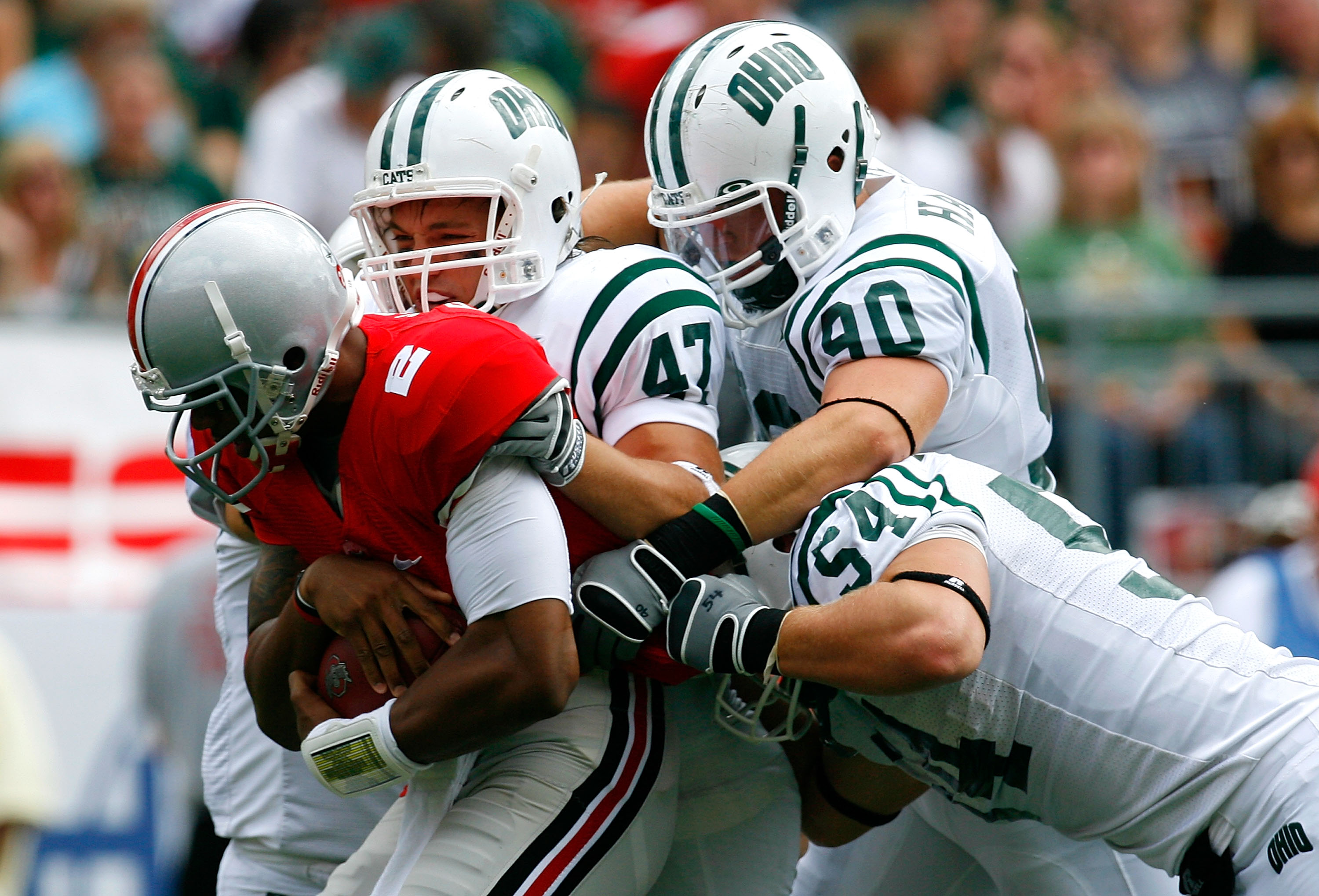COLUMBUS, OH - SEPTEMBER 06:  Backup quarterback Terrelle Pryor #2 of the Ohio State Buckeyes is tackled by defenders Noah Keller #47, Kris Luchsinger #54 and Jameson Hartke #90 of the Ohio Bobcats during the game at Ohio Stadium on September 6, 2008 in C