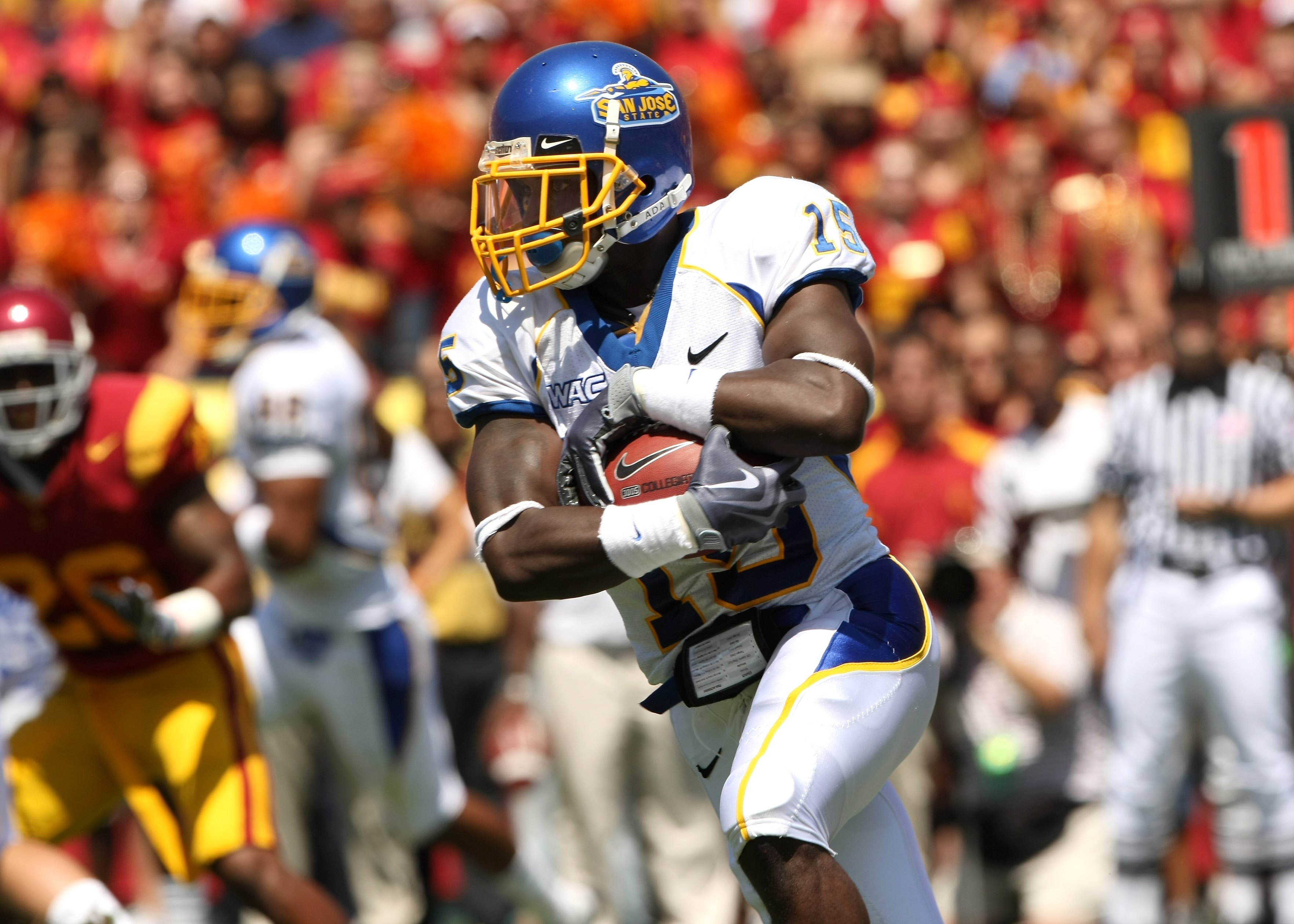 LOS ANGELES, CA - SEPTEMBER 05:  Running back Brandon Rutley #15 of the San Jose State Spartans  carries the ball against the USC Trojans at the Los Angeles Coliseum in Los Angeles, California.   USC won 56-3.  (Photo by Stephen Dunn/Getty Images)