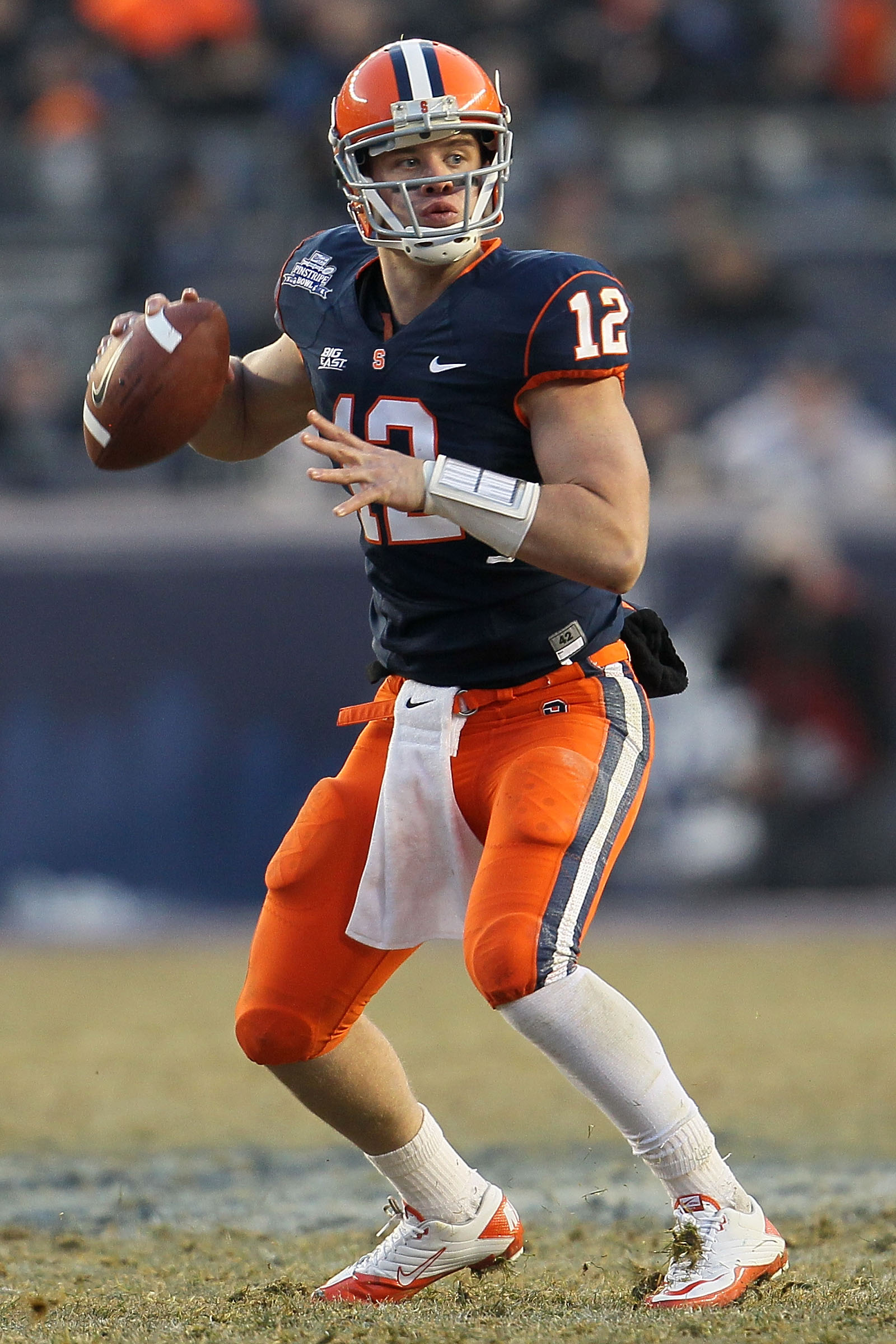 NEW YORK, NY - DECEMBER 30:  Quarterback Ryan Nassib #12 of the Syracuse Orange looks to pass against the Kansas State Wildcats during the New Era Pinstripe Bowl at Yankee Stadium on December 30, 2010 in New York, New York.  (Photo by Chris McGrath/Getty