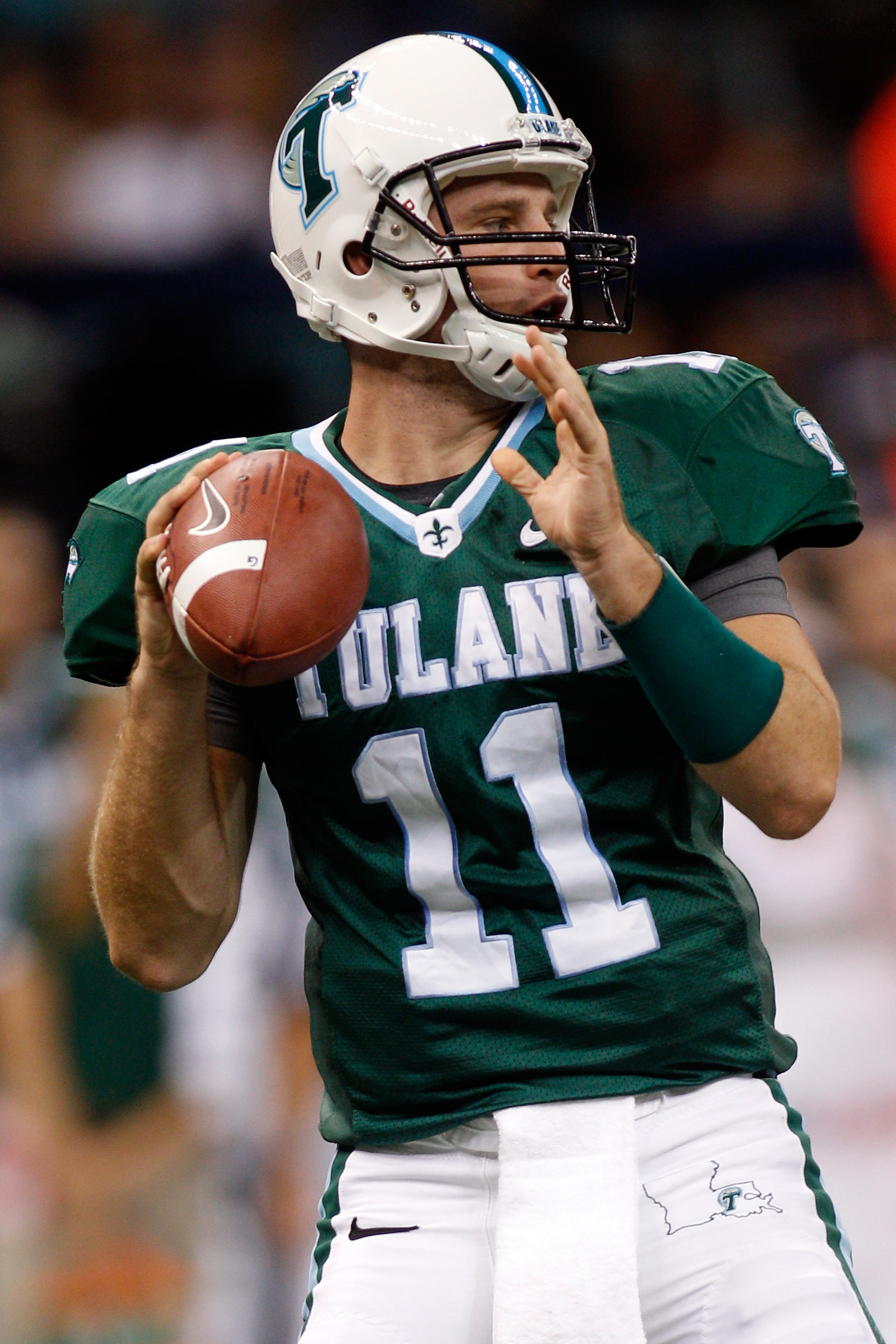NEW ORLEANS - SEPTEMBER 11:  Ryan Griffin #11 of the Tulane Green Wave looks to throw a pass against the Ole Miss Rebels at the Louisiana Superdome on September 11, 2010 in New Orleans, Louisiana.  (Photo by Chris Graythen/Getty Images)
