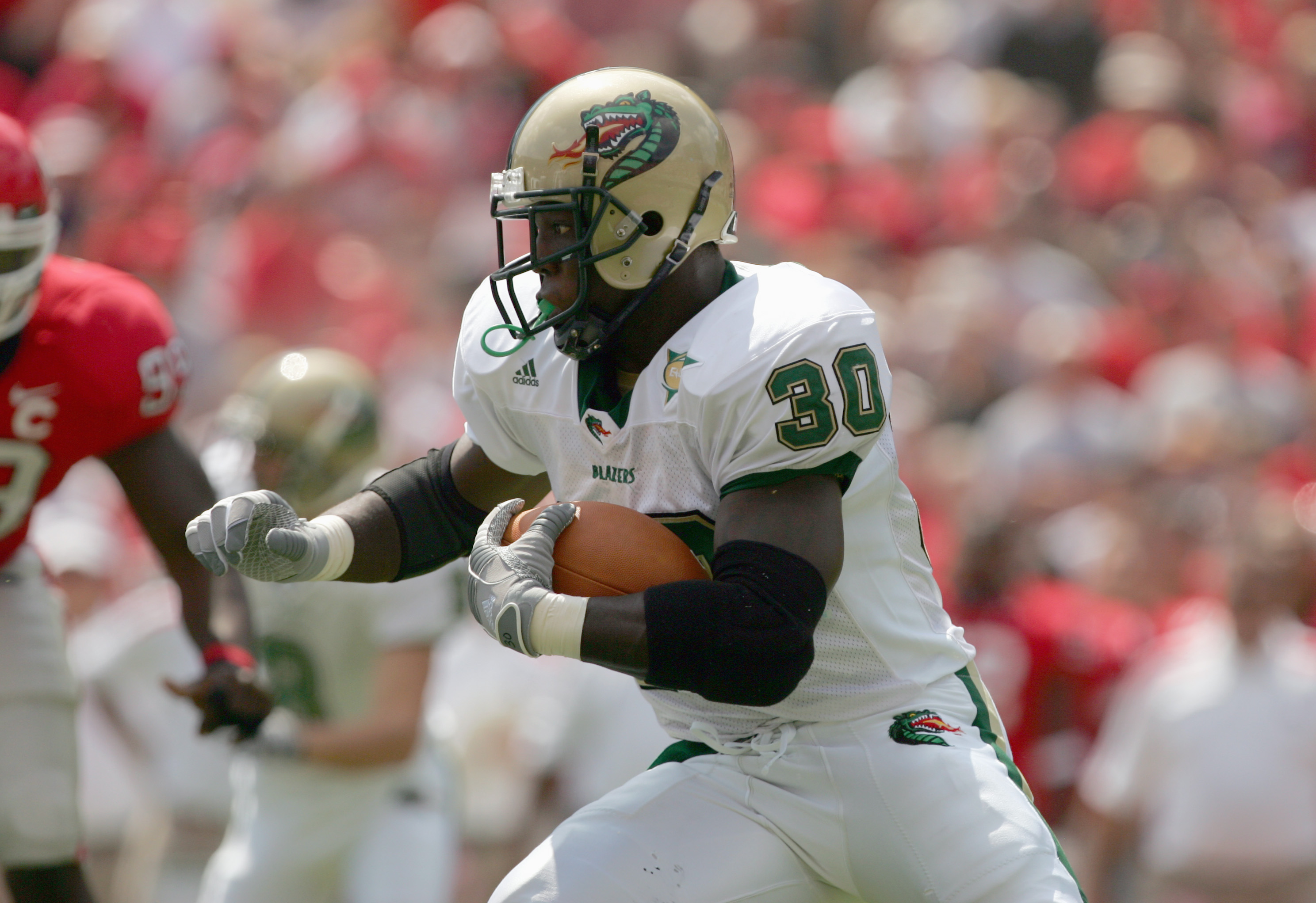 ATHENS, GA - SEPTEMBER 16:  Corey White #30 of the UAB Blazers carries the ball during their game against the Georgia Bulldogs on September 16, 2006 at Sanford Stadium in Athens, Georgia. (Photo by Streeter Lecka/Getty Images)