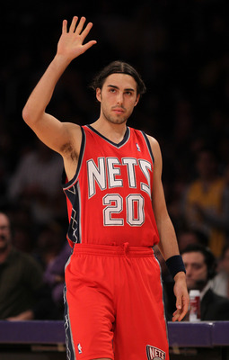 LOS ANGELES, CA - JANUARY 14:  Sasha Vujacic #20 of the New Jersey Nets waves to the crowd as he enters the game in his first return since being traded by the Los Angeles Lakers at Staples Center on January 14, 2011 in Los Angeles, California.  NOTE TO US