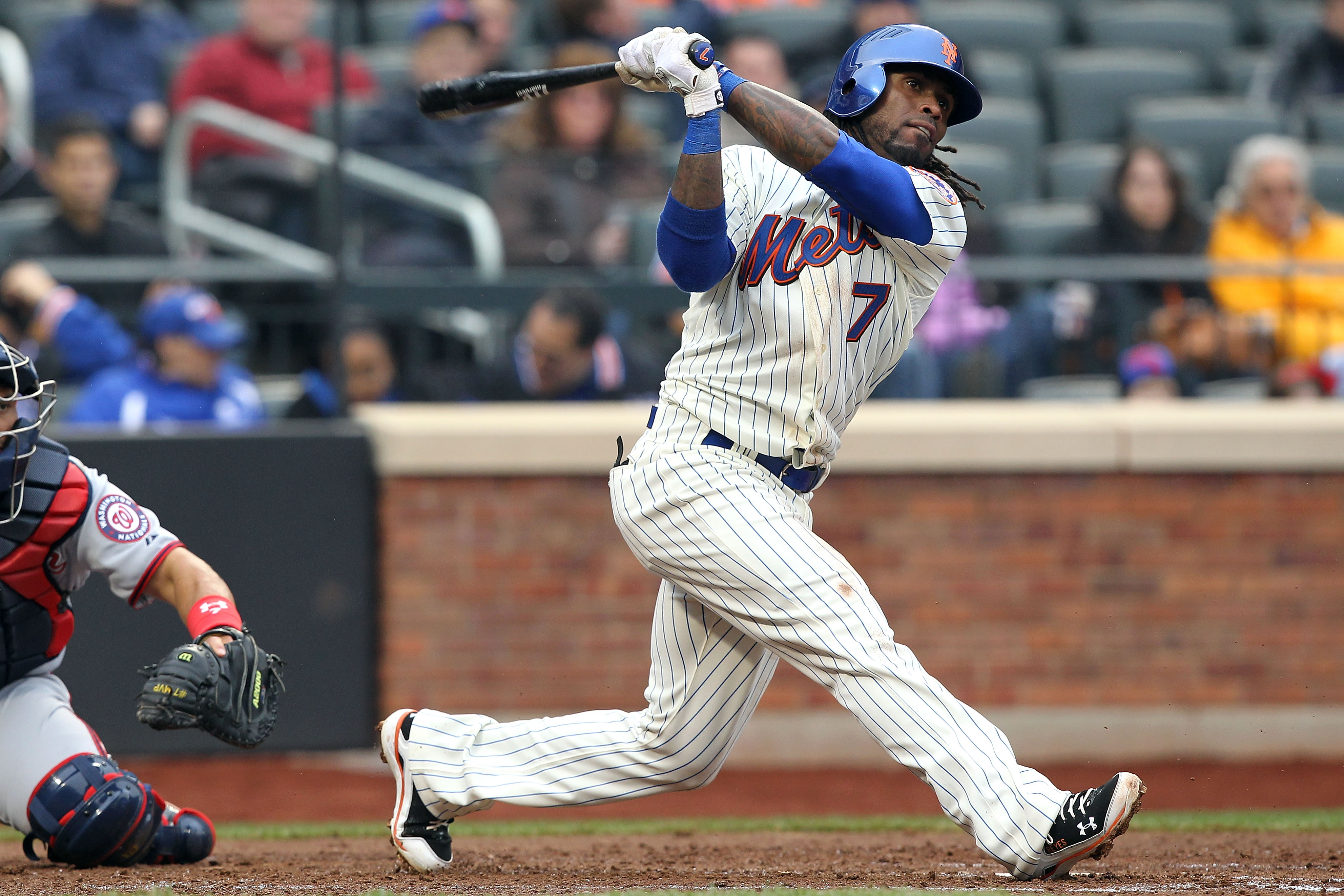 NEW YORK, NY - APRIL 08:  Jose Reyes #7 of the New York Mets bats against the Washington Nationals during the Mets' Home Opener at Citi Field on April 8, 2011 in the Flushing neighborhood of Queens in New York City. The Nationals won 6-2. (Photo by Al Bel