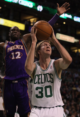 BOSTON, MA - MARCH 02:  Troy Murphy #30 of the Boston Celtics takes a shot as Mickael Pietrus #12 of the Phoenix Suns defends on March 2, 2011 at the TD Garden in Boston, Massachusetts.  NOTE TO USER: User expressly acknowledges and agrees that, by downlo