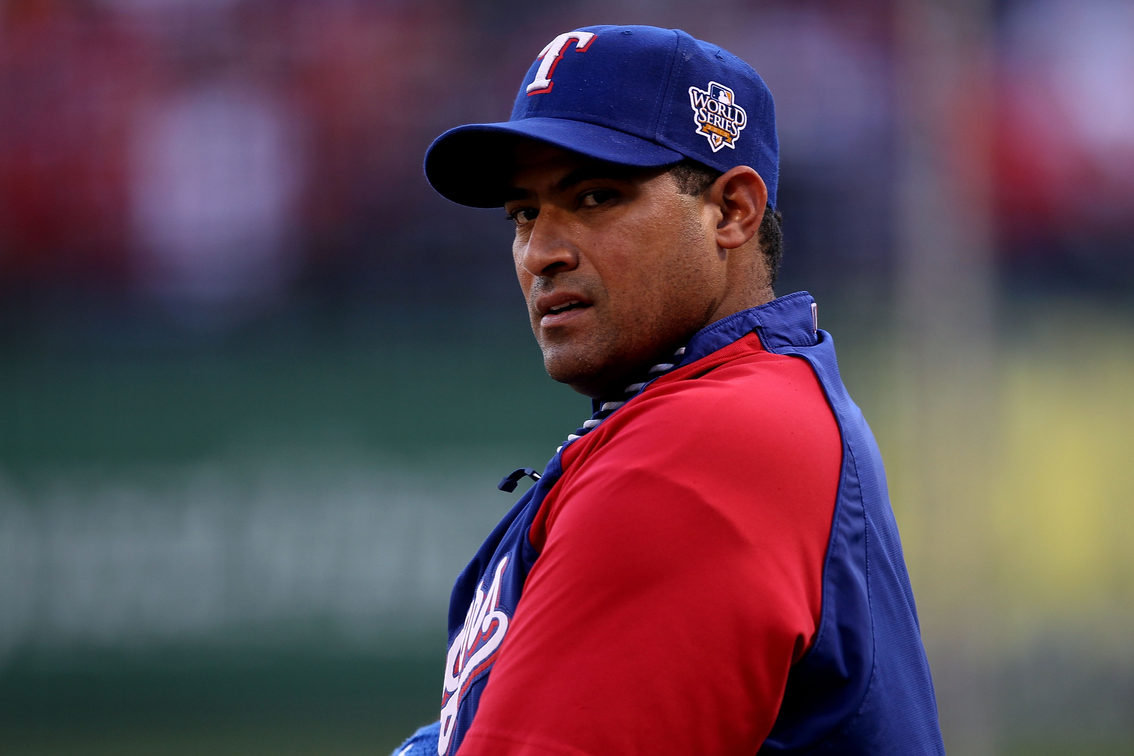 ARLINGTON, TX - OCTOBER 31:  Bengie Molina #11 of the Texas Rangers looks on during batting practice against the San Francisco Giants in Game Four of the 2010 MLB World Series at Rangers Ballpark in Arlington on October 31, 2010 in Arlington, Texas.  (Pho