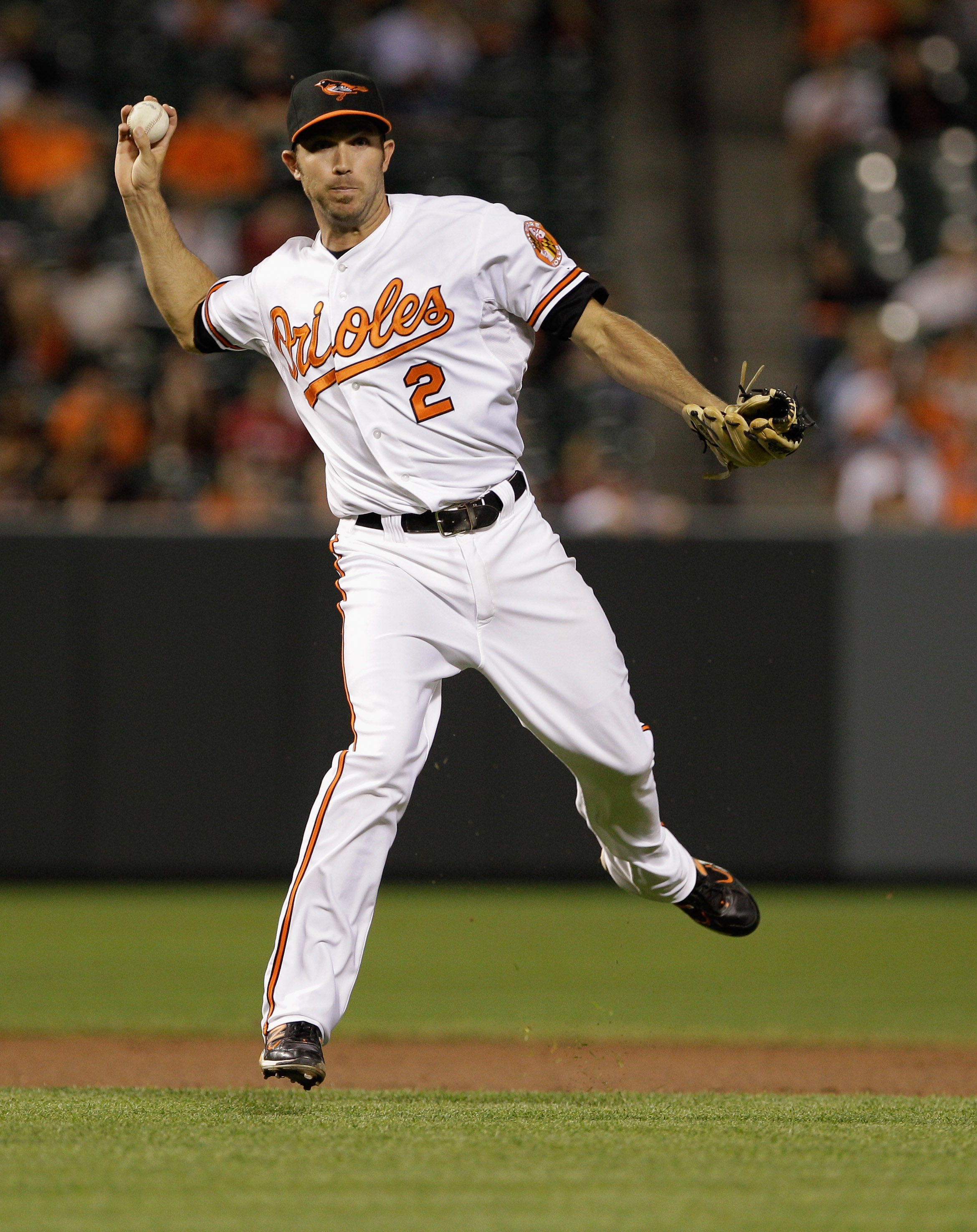 BALTIMORE, MD - MAY 12: J.J. Hardy #2 of the Baltimore Orioles in action against the Seattle Mariners at Oriole Park at Camden Yards on May 12, 2011 in Baltimore, Maryland.  (Photo by Rob Carr/Getty Images)