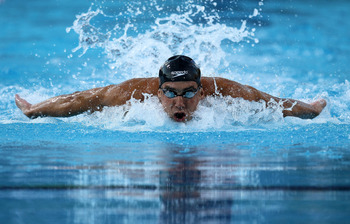 IRVINE, CA - AUGUST 20:  Michael Phelps swims on his way to winning the men's 100m butterfly during the Mutual of Omaha Pan Pacific Championships at the William Woollett Jr. Aquatic Center on August 20, 2010 in Irvine, California.  (Photo by Stephen Dunn/