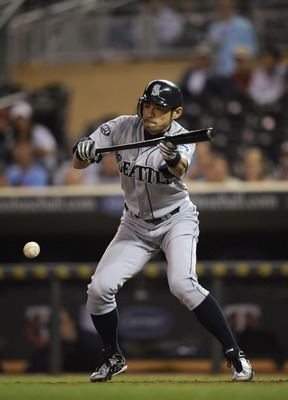 MINNEAPOLIS, MN - MAY 23: Ichiro Suzuki #51 of the Seattle Mariners bunts against the Minnesota Twins during their game on May 23, 2011 at Target Field in Minneapolis, Minnesota. The Rockies won 6-5. (Photo by Hannah Foslien/Getty Images)