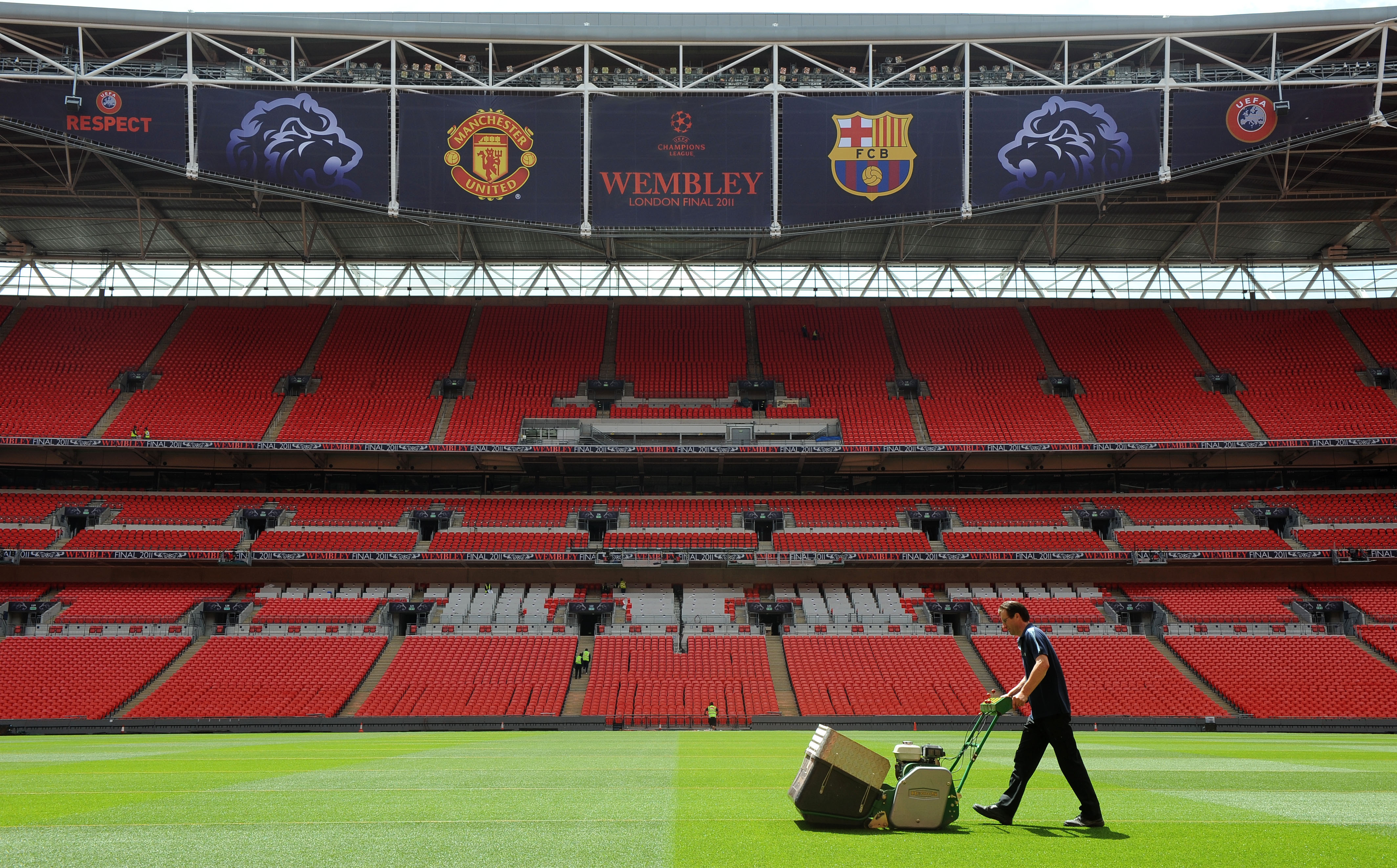 LONDON, UNITED KINGDOM - MAY 24:  In this handout image provided by UEFA, final preparations are made to the pitch at Wembley Stadium for the Champions League Final, May 24, 2011  in London, England. The UEFA Champions League final between FC Barcelona an
