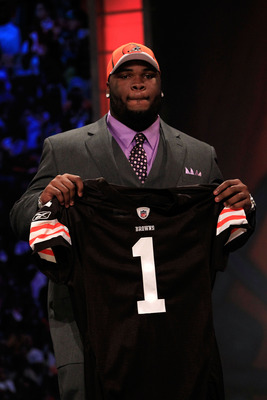 NEW YORK, NY - APRIL 28:  Phil Taylor, #21 overall pick by the Cleveland Browns, holds up a jersey on stage during the 2011 NFL Draft at Radio City Music Hall on April 28, 2011 in New York City.  (Photo by Chris Trotman/Getty Images)