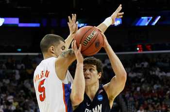 NEW ORLEANS, LA - MARCH 24:  Jimmer Fredette #32 of the Brigham Young Cougars goes up against Scottie Wilbekin #5 of the Florida Gators during the Southeast regional of the 2011 NCAA men's basketball tournament at New Orleans Arena on March 24, 2011 in Ne