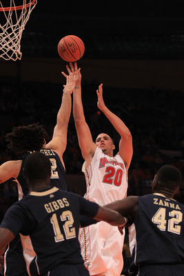 NEW YORK - NOVEMBER 18:  Jordan Williams #20 of the Maryland Terrapins shoots over Gary McGhee #52 of the Pittsburgh Panthers during the 2k Sports Classic at Madison Square Garden on November 18, 2010 in New York, New York.  (Photo by Chris McGrath/Getty