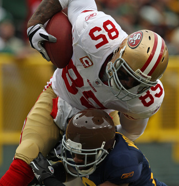 GREEN BAY, WI - DECEMBER 05: Vernon Davis #85 of the San Francisco 49ers is hit by Chales Woodson #21 of the Green Bay Packers at Lambeau Field on December 5, 2010 in Green Bay, Wisconsin. The Pacekrs defeated the 49ers 34-16. (Photo by Jonathan Daniel/Ge