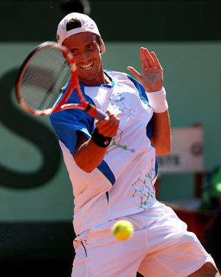 PARIS, FRANCE - JUNE 01:  Juan Ignacio Chela of Argentina hits a forehand during the men's singles quarterfinal match between Andy Murray of Great Britain and Juan Ignacio Chela of Argentina on day eleven of the French Open at Roland Garros on June 1, 201