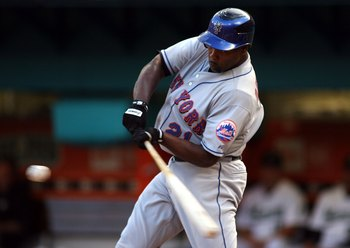 MIAMI - JULY 30:  Carlos Delgado #21 of the New York Mets bats against the Florida Marlins in the third inning on July 30, 2008 at Dolphin Stadium in Miami, Florida.  The Marlins defeated the Mets 7-4.  (Photo by Marc Serota/Getty Images)